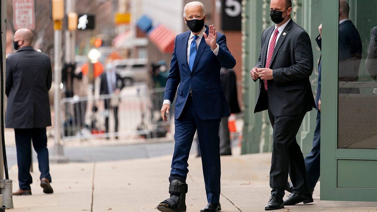 Biden shows off walking boot for first time since injury ...